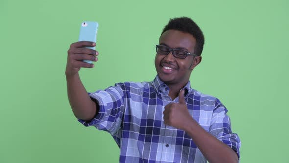 Thumbnail for Happy Young African Hipster Man Taking Selfie