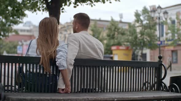 Thumbnail for Couple Sitting on Bench and Holding Hands