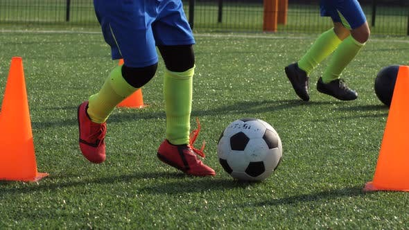 Thumbnail for Feet of Football Players During Dribbling on Field