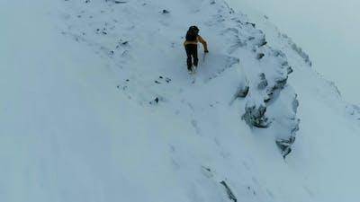 Mountain Climber Ascending a Difficult Rock Face