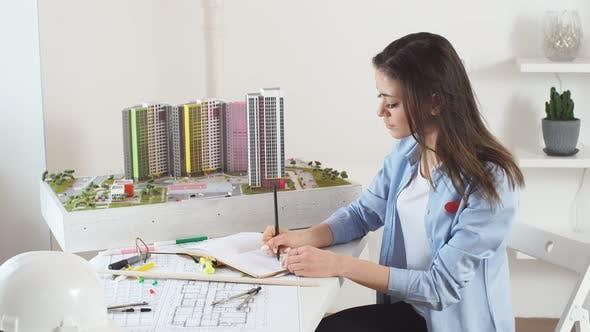 Smiling Cheerful Woman Enjoying Designing Urban Area