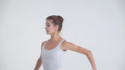 Dramatic Dance, Elegant Female in a White Tutu, Dance Ballet and Perform Choreographic Elements on a