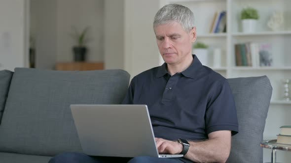 Thumbnail for Middle Aged Businessman with Laptop Smiling at Camera