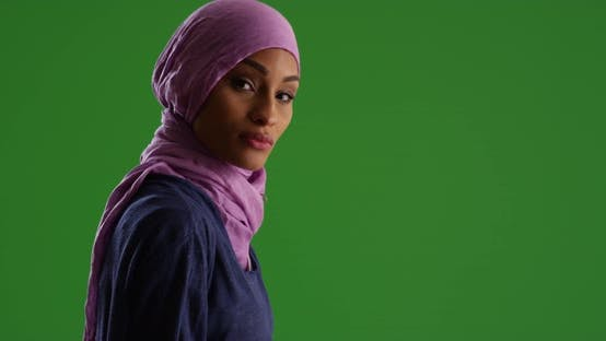 Thumbnail for Female in hijab texting on cellphone on green screen