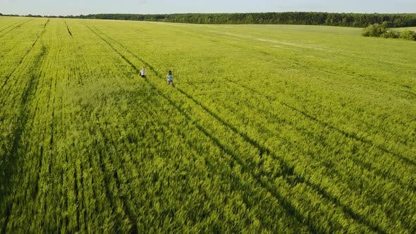 Thumbnail for Small Family Walking in Field