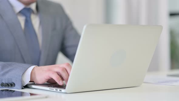 Close Up of Businessman Typing on Laptop