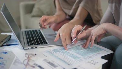 Women Doing Tax Returns Together