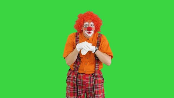 Funny Clown Coming Up with Hard Decision on a Green Screen Chroma Key
