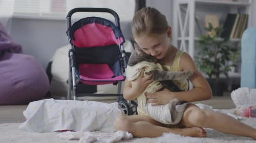 Girl Pampering a Cat