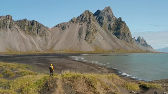 Aerial Drone Circle Movement Arount Man and Stokksnes Landscape in Iceland