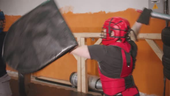 Thumbnail for Two Men Having a Training Fight in the Gym Using a Safe Sword and Shield