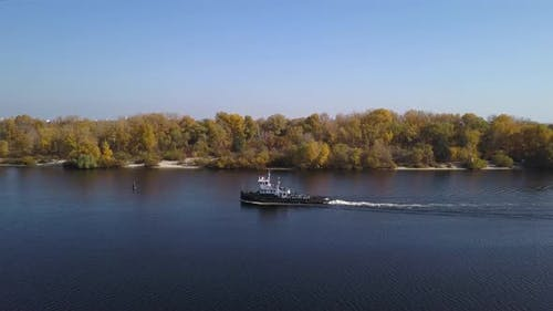 Aerial: The ship goes by Dnipro river in autumn