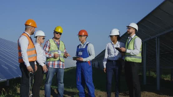 Electrical Workers Inspecting a Solar Farm