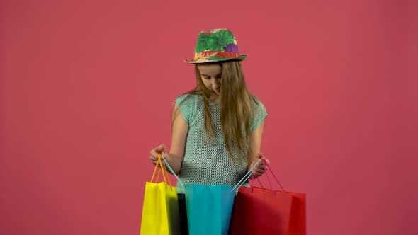 Thumbnail for Girl Gets a Red Shoe From the Bag and She Is Happy That the Shopaholic Loves Shopping