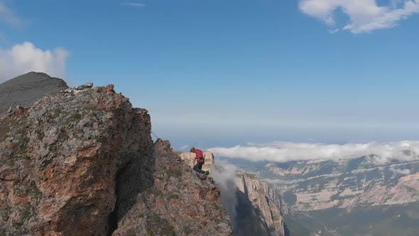 Thumbnail for Aerial Shot of Group of Climbers Working with a Rope. Rescue Work Climbing To the Top of the