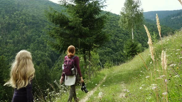 Thumbnail for Mother With Daughters Hiking At The Mountains
