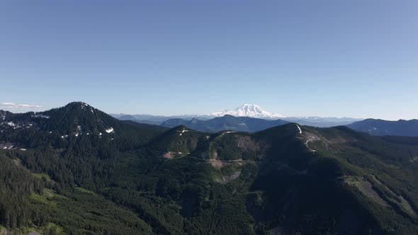 Thumbnail for Washington Cascade Mountains Aerial With Mt Rainier And Spring Blue Sky
