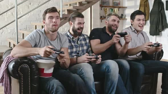 Thumbnail for Male Friends Playing Video Games