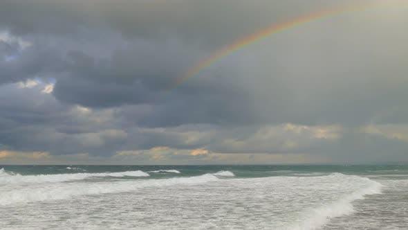 Rainbow over the Stormy Sea