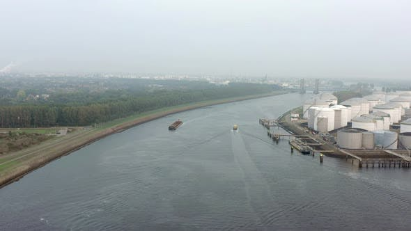 Thumbnail for Cargo Ship in the Port of Rotterdam in the Late Hazy Evening