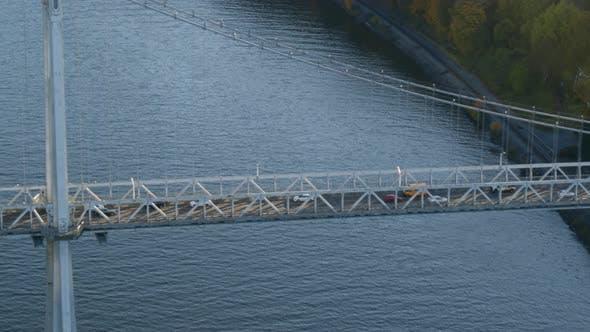 Aerial of vehicles riding on Mid-Hudson Bridge over Hudson river