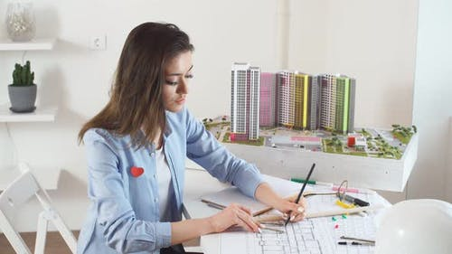 Confident Satisfied Smiling Brunette Woman Creating New Models of Building