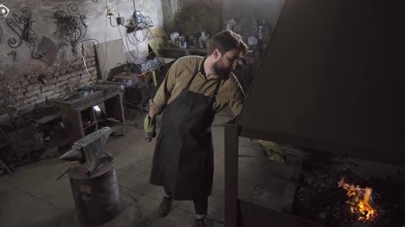 Thumbnail for Male Worker Forging Metal Billet in Workshop