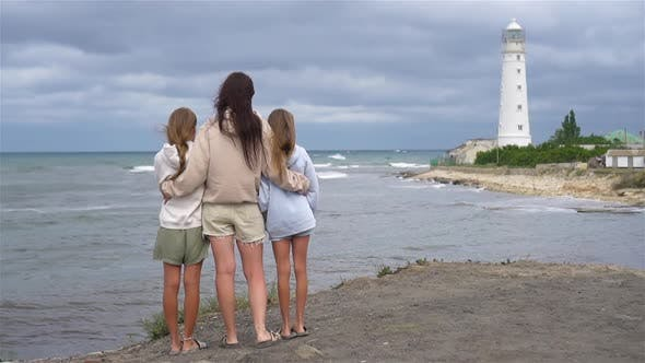 Thumbnail for Family of Three Walk To the Lighthouse