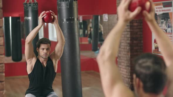 Thumbnail for Fitness Man Training Squat Exercise with Ball in Fitness Gym