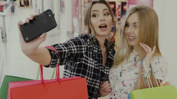 Thumbnail for Blond and Brunette Doing Selfie After Shopping