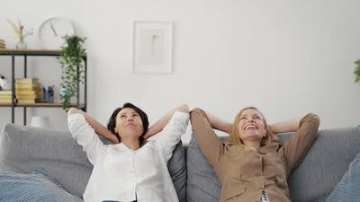 Two Women Relaxing on Couch