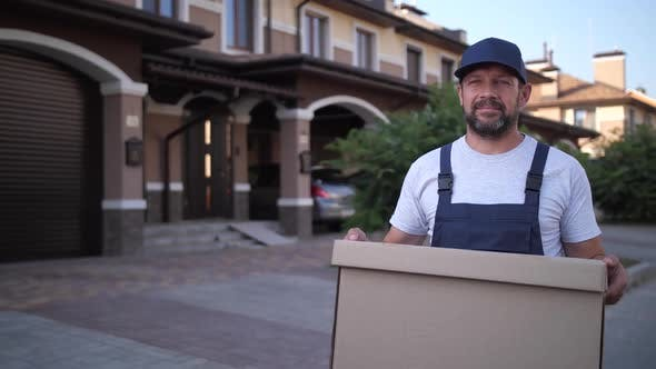 Cover Image for Employee of Delivery Service Carrying Box Outdoors