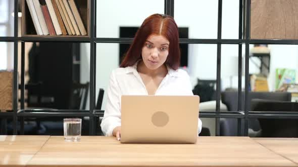Thumbnail for Young Girl Working on Laptop
