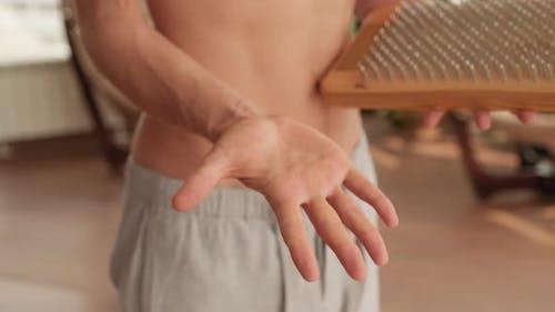 Man Touching Sadhu Nail Board With Palm
