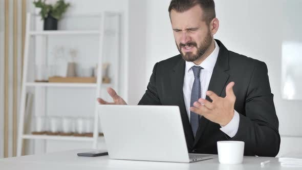 Thumbnail for Loss, Frustrated Businessman Working on Laptop