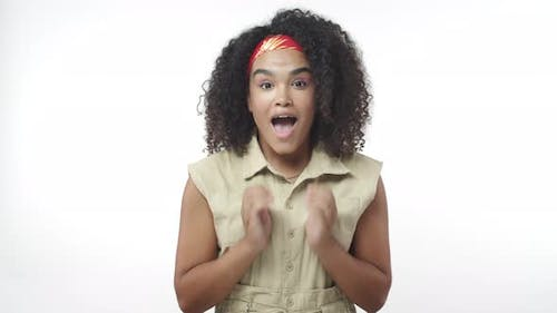 Cheerful Silly African American Female with Afro Wear Headband Look with Admiration and Affection