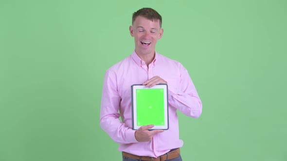 Thumbnail for Happy Businessman Talking While Showing Digital Tablet