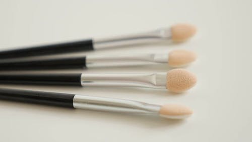 Panning over eyeshadow makeup  brushes 4K 2160p 30fps UltraHD  video - Close-up of brushes for beaut