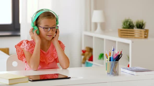 Thumbnail for Girl in Headphones Listening To Music at Home
