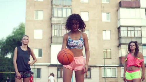 A Group of Women are Playing Basketball