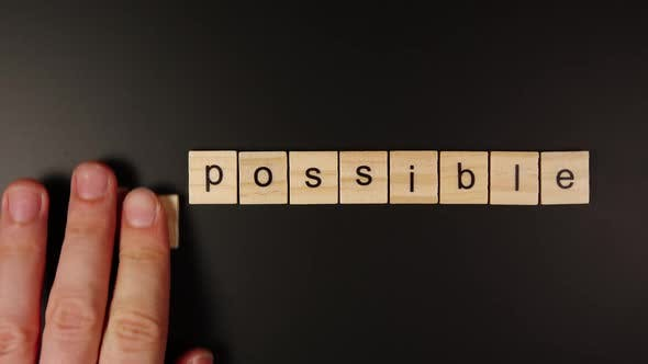 Thumbnail for TOP VIEW: From Impossible To Possible - Human Hand Takes Out A Few Letters