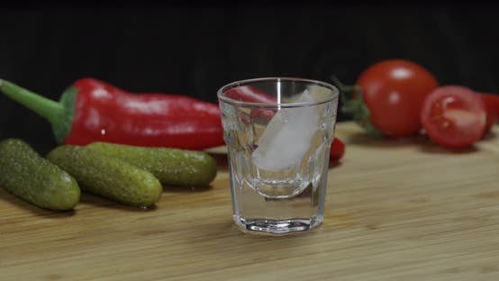 Thumbnail for Man Puts a Glass Then Fills It with Vodka and Picks Up a Glass