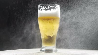 Cold Beer In A Glass With Water Drops. Craft Beer Close Up. Like rain water