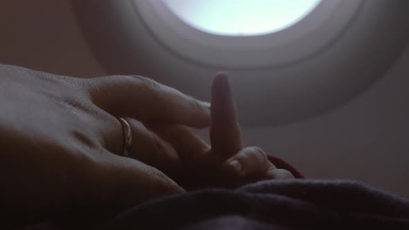 Cover Image for Mother and Baby Hands, View in Airplane