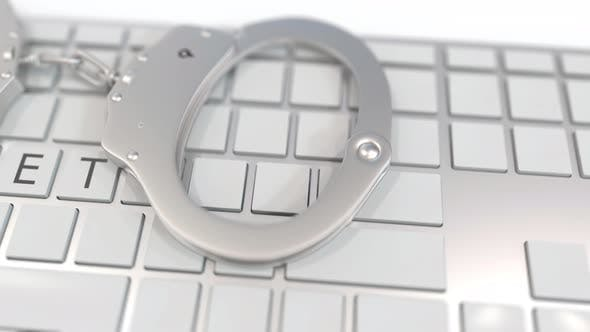 Thumbnail for Handcuffs on Keyboard with DARKNET Text on Keys