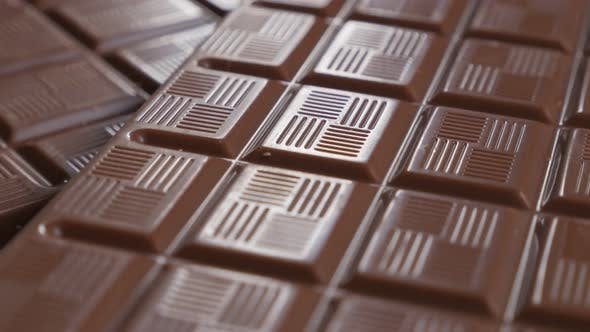 Thumbnail for Chocholate blocks in a row fine glazed texture 4K 3840X2160 30fps UltraHD video - Slow tilt over dar