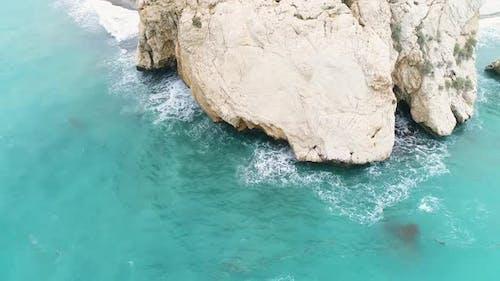 Aerial Top View of Cliff Rocks in a Blue Ocean