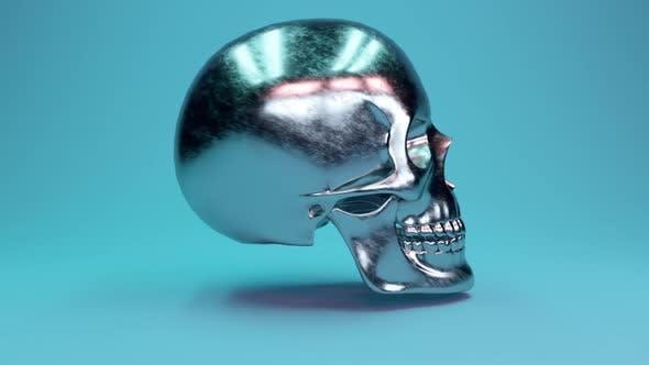 Thumbnail for Ein zerkratzter menschlicher Schädel aus Metall ist um 360 Grad drehbar.