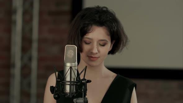 Thumbnail for The Girl Sings at Restaurant