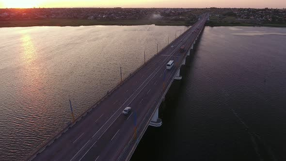 Thumbnail for Aerial Shot of a Lanky Bridge Over the Dnipro at a Dreamy Sunset in Summer